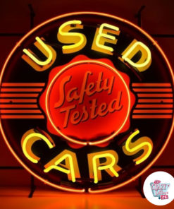 Neon Used Cars sign lit